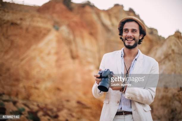 Handsome man photographer