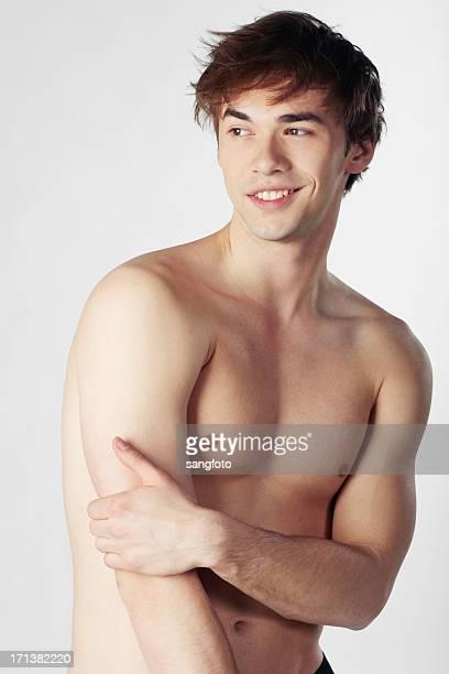 笑顔のハンサムな男性のポートレートて先 - セミヌード ストックフォトと画像