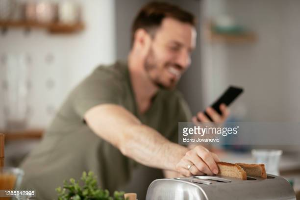 handsome man preparing breakfast at home