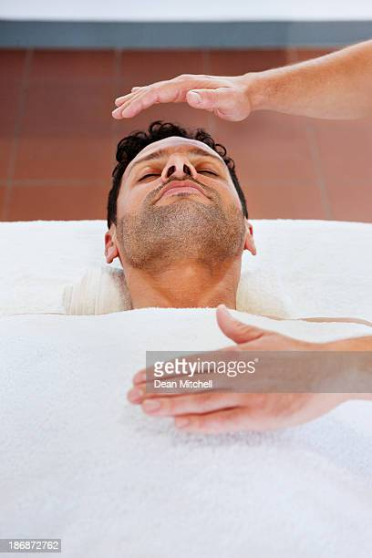 Handsome Man Receiving New Age Therapy