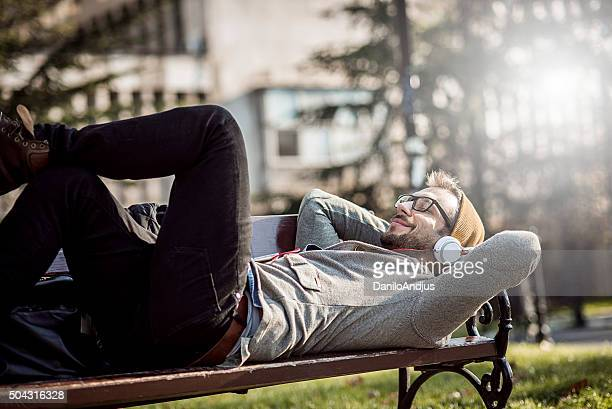 handsome man relaxing in the park