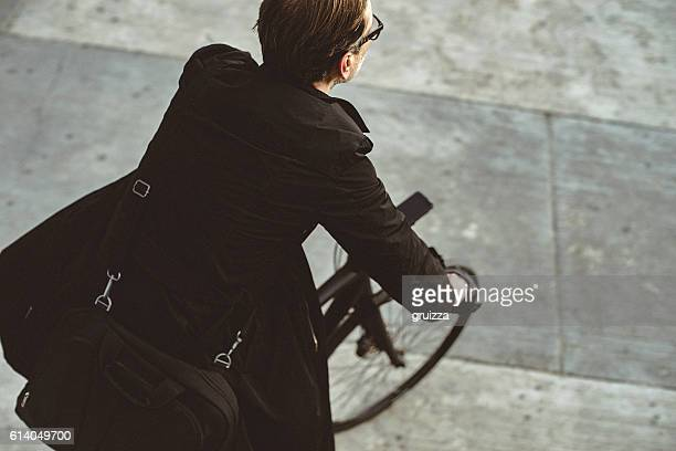 Handsome man riding bicycle in the city