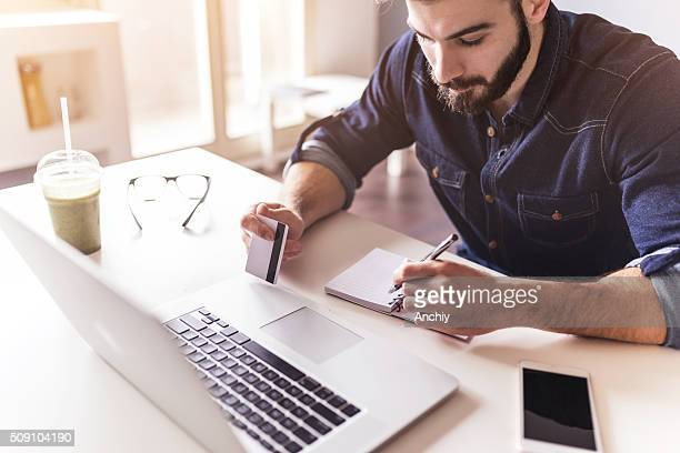 handsome man shopping online - the internet stock pictures, royalty-free photos & images