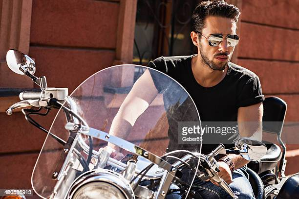 Handsome man sitting on motorbike