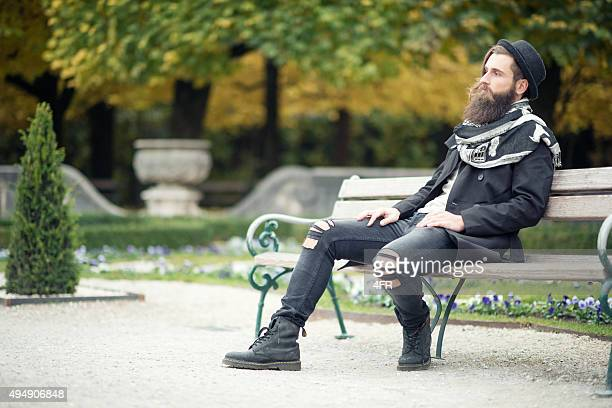 Handsome Man sitting on Park Bench, Male Fashion, Fall Colors