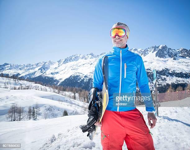 Handsome man snowboarding