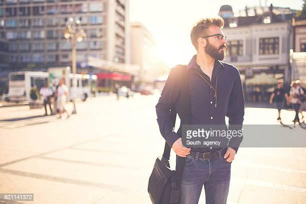 Handsome man taking a walk