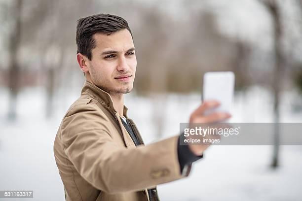 Handsome Man Taking Selfie