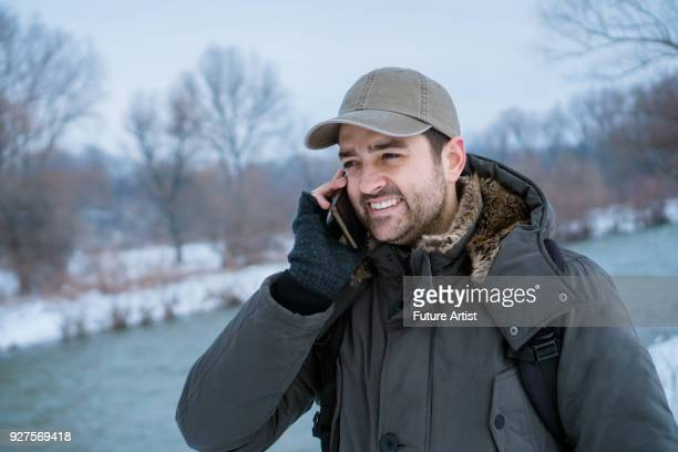 Handsome man talking on cell phone