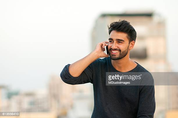 handsome man talking on mobile phone. - indian stock pictures, royalty-free photos & images