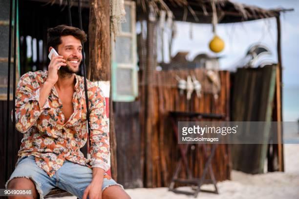 Handsome man talking on mobile phone