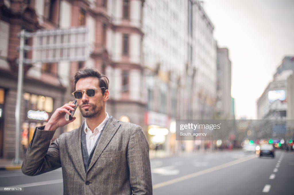 Handsome man talking on the phone : Stock Photo