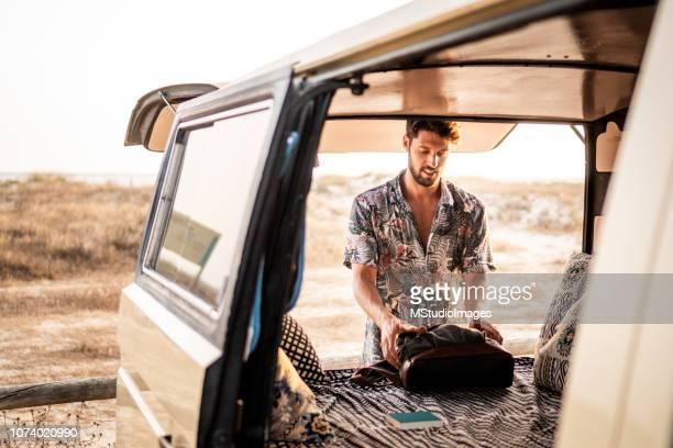 Handsome man traveling in a van.