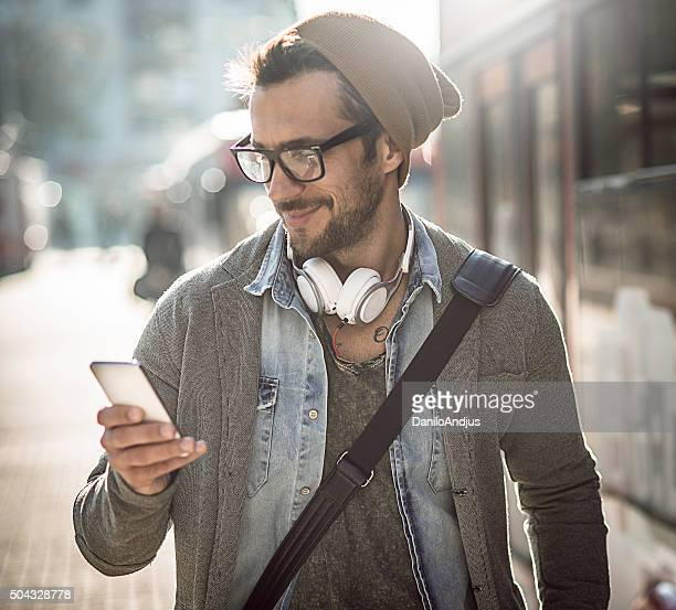 handsome man typing a text message