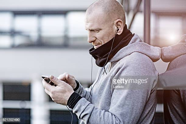 handsome man using his phone for jogging