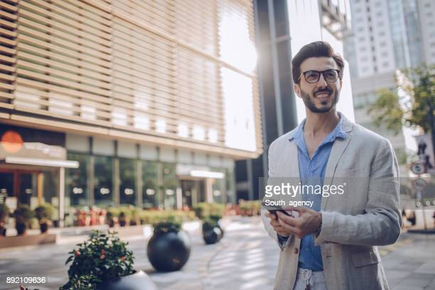 Handsome man using mobile