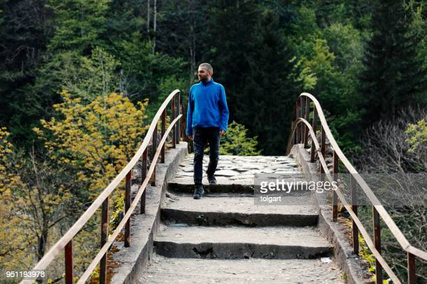handsome man walking in the spring park - trabzon stock photos and pictures