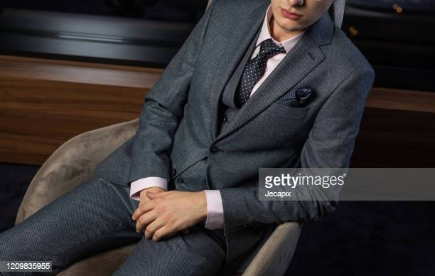 handsome man wearing suit - men fashion stock pictures, royalty-free photos & images