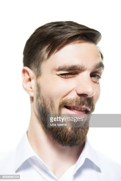 handsome man winking at camera - seduction stock pictures, royalty-free photos & images