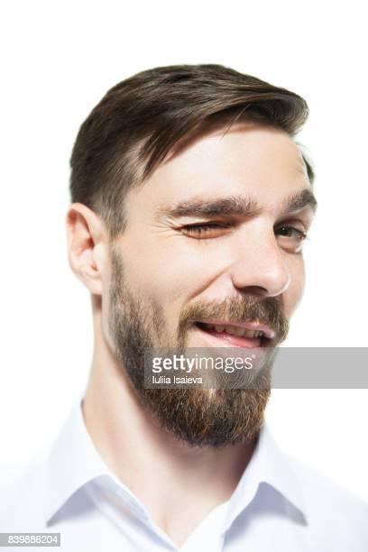 Handsome man winking at camera