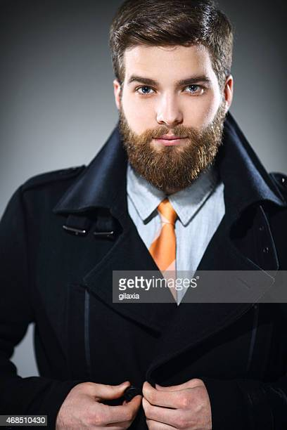 Handsome man with beard in formalwear.