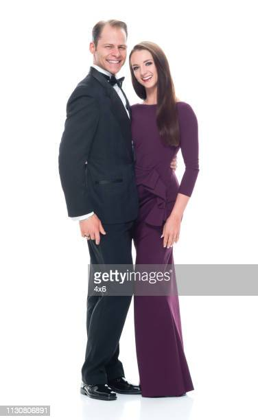 handsome man with beautiful woman on white background - tuxedo stock pictures, royalty-free photos & images