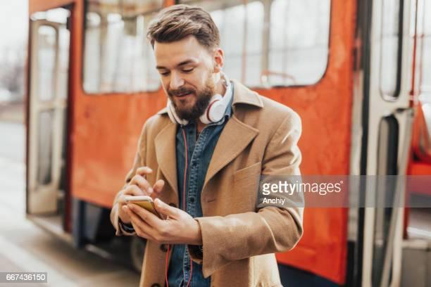 Handsome man with headphones around his neck