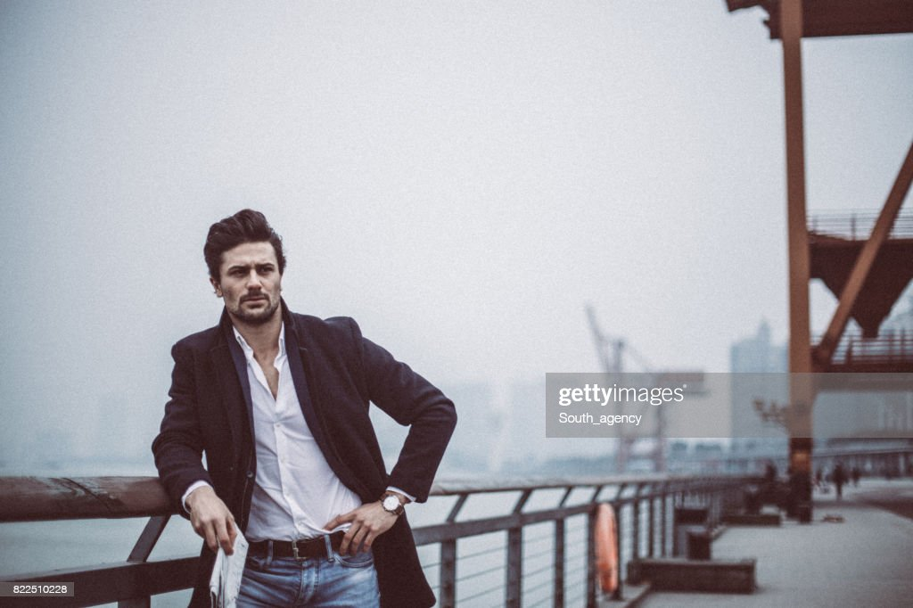 Handsome man with newspaper : Stock Photo