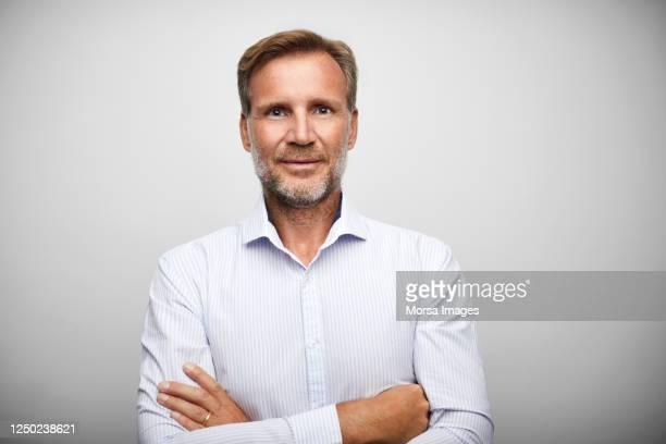 handsome mature businessman with stubble. - solo un uomo maturo foto e immagini stock