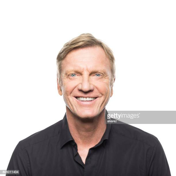 handsome mature man smiling - handsome 50 year old men stock photos and pictures