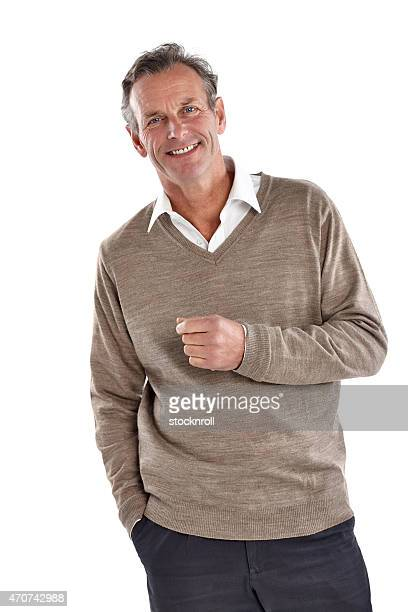 Handsome mature man standing in studio