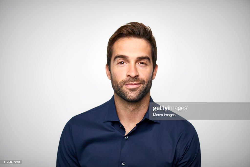Handsome mid adult businessman with stubble : Foto stock