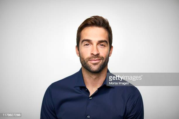 handsome mid adult businessman with stubble - camicia foto e immagini stock