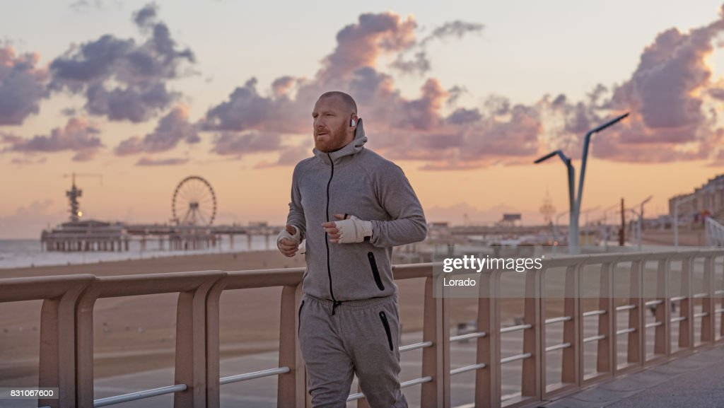 Handsome Middle Aged Bearded Man Exercising Outdoors in Northern Europe : Stock Photo