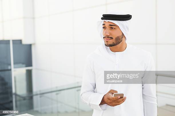 Handsome Middle Eastern Man On The Phone Outside Office