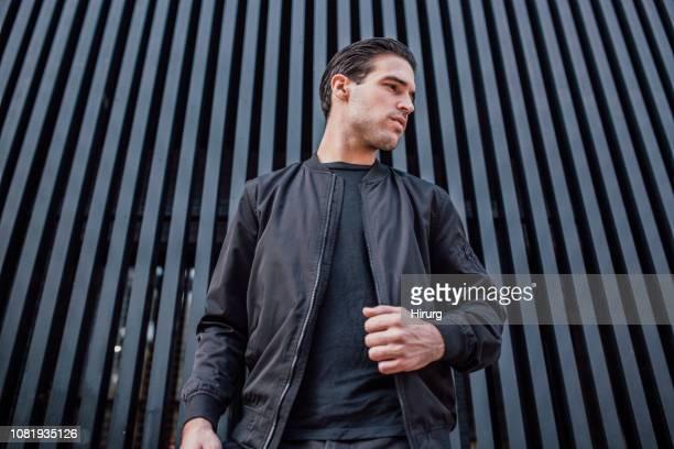 handsome model posing - inquadratura dal basso foto e immagini stock