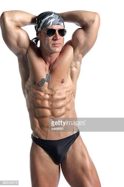 Handsome muscular man posing