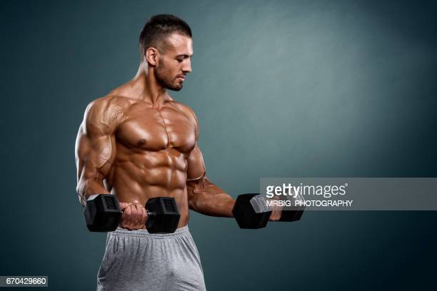 Handsome Muscular Men Exercise With Weights