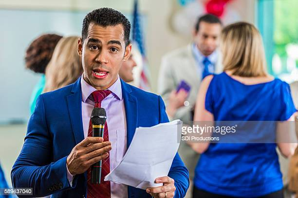 handsome news reporter reads information - american tv presenters stock pictures, royalty-free photos & images
