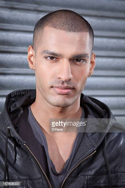 handsome pakistani man smiling - handsome pakistani men stock photos and pictures
