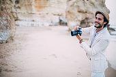 tourist man standing at beach making