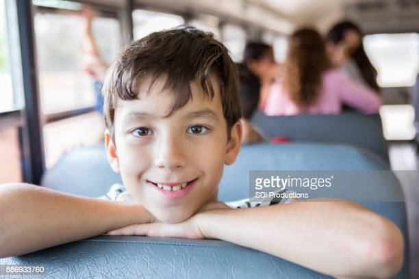 Handsome preteen boy on school bus