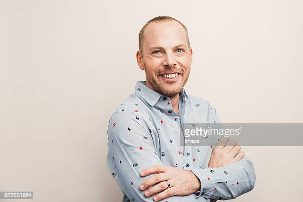 handsome real man in christmas shirt smiling - part of a series stock pictures, royalty-free photos & images