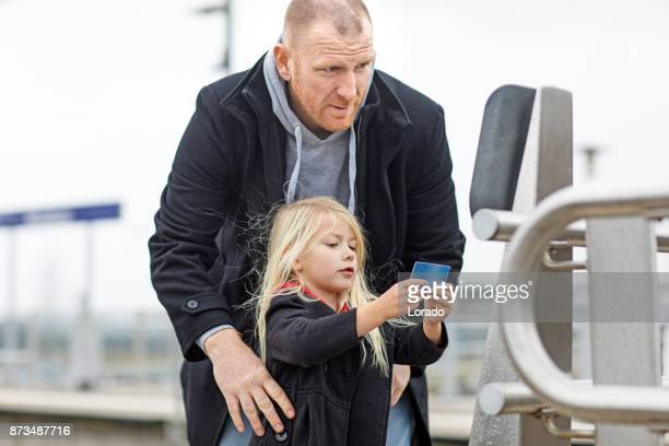 handsome redhead middle aged father and cute blonde daughter traveling on public transport - south holland stock pictures, royalty-free photos & images