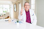 handsome senior doctor man wearing medical