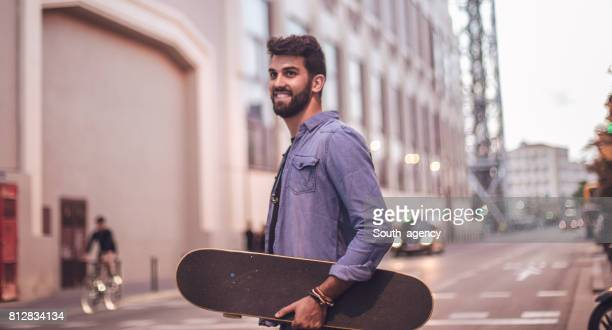 handsome skater in city - one man only stock pictures, royalty-free photos & images