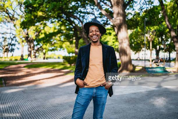 handsome smiling man in park - medium shot stock pictures, royalty-free photos & images