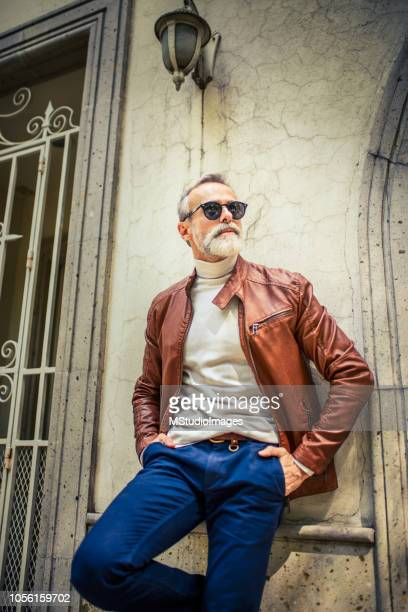 handsome smiling mature man. - brown jacket stock pictures, royalty-free photos & images