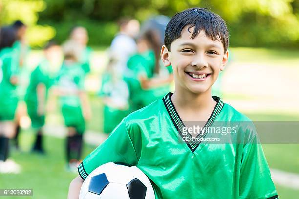 Handsome soccer player after game