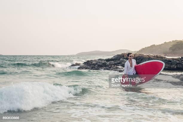 Handsome surfer